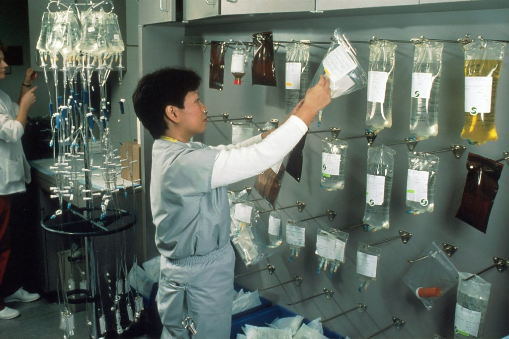 a nurse taking some vials of blood