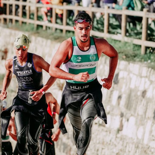 strong athletes sprinting during triathlon race
