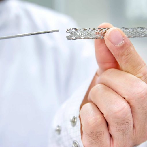Man Holding Heart Stent In Hand